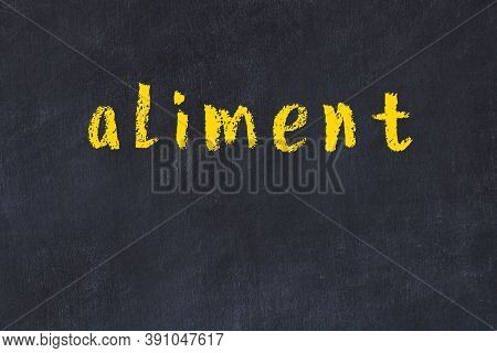 Chalk Handwritten Inscription Aliment On Black Desk