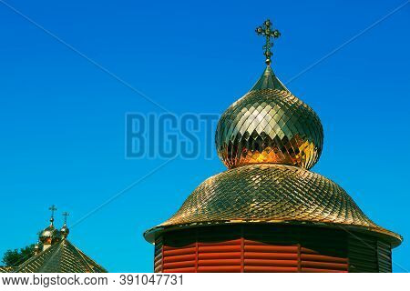 Golden Church Cupola With Cross On The Top