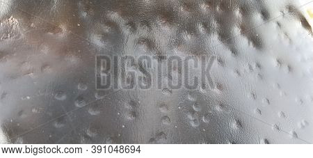 Bronze Metal Surface. Uneven Metal Texture With Scratches, Gouges And Dents. Red, Brown, Orange, Bro