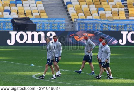 Kyiv, Ukraine - October 13, 2020: Head Coach Luis Enrique (l) And His Assistants Walks On The Pitch