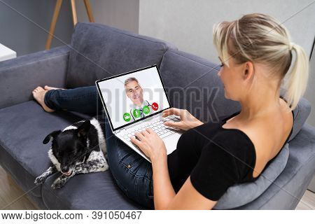 Web Video Conference Call With Doctor On Laptop Computer