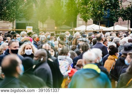 Defocused View Of Unrecognizable People Gathering In The Central Square During A Protest Wearing Blu