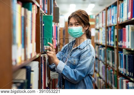 Asian University Student Girl Wearing Face Protective Medical Mask For Protection From Virus Disease