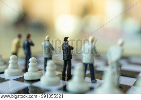 Business, Teamwork Concept. Group Of Businessman Miniature Figure People Standing On Chessboard With