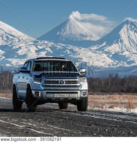 Japanese Sport Utility Vehicle Toyota Tundra Driving Along Road On Background Of Kamchatka Winter La