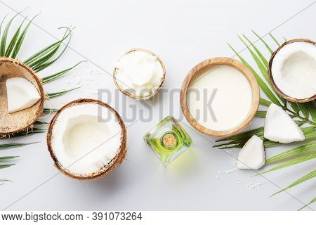 Coconuts Products - Mct Butter, Oil, Milk, Oil, Shavings On Grey Background. Copy Space. Hair, Skin