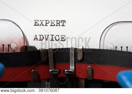Expert advice phrase written with a typewriter.