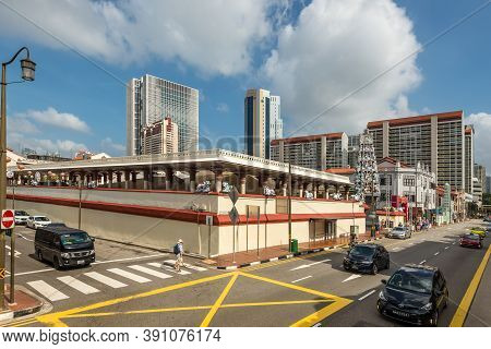 Singapore - December 4, 2019: Street View Of Chinatown Singapore At Sunny Day With Hindu Temple And