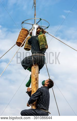 Verona, Italy - Sept 20, 2020: Albero Or Palo Della Cuccagna, Climbing The Greasy Pole Of Cockaigne.
