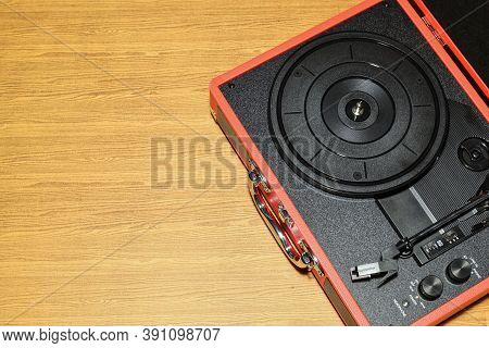 Top View Of Vinyl Record Player On The  Table. Vinyl Record Player Is A Music Player That Record On