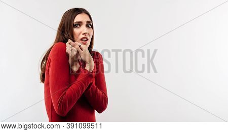 I'm Afraid. Image Of Young Scared Woman With Long Chestnut Hair In Casual Red Sweater. Fright, Phobi