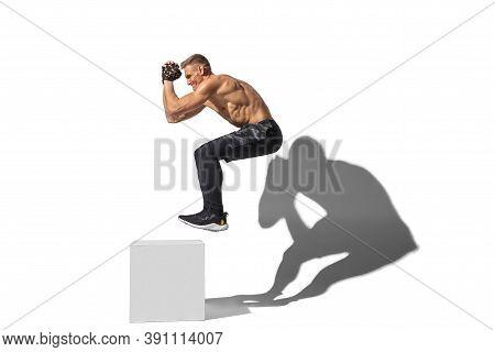 Activity, Jumpbox. Stylish Young Male Athlete On White Studio Background, Portrait With Shadows. Spo