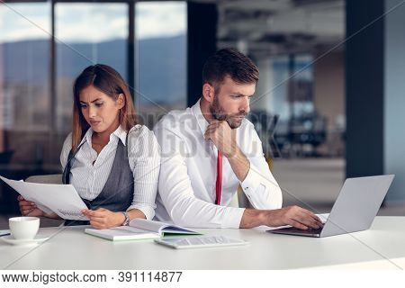 Business Conflict. Business People Arguing About Document At The Office