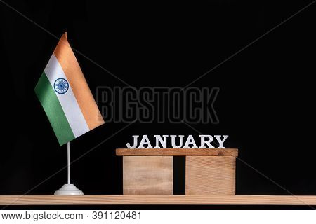 Wooden Calendar Of January With Indian Flag On Black Background. Holidays Of India In January.