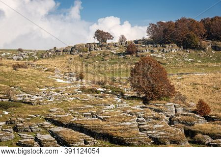 Landscape Of The Lessinia Plateau In Autumn With Karst Erosion Formations, Regional Natural Park In