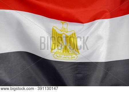 Fabric Texture Flag Of Egypt. Flag Of Egypt Waving In The Wind. Egypt Flag Is Depicted On A Sports C