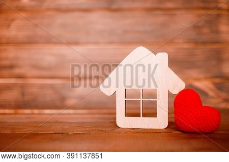 Wooden House With Little Heart On Wooden Background Horizontal. Copy Space