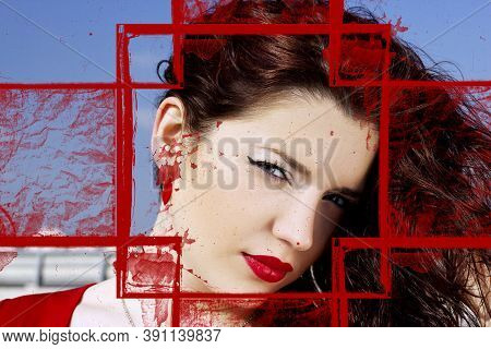 Portrait Of A Glamorous Pretty Girl With Long Red Hair. A Pretty Woman Posing On A Background Of A S