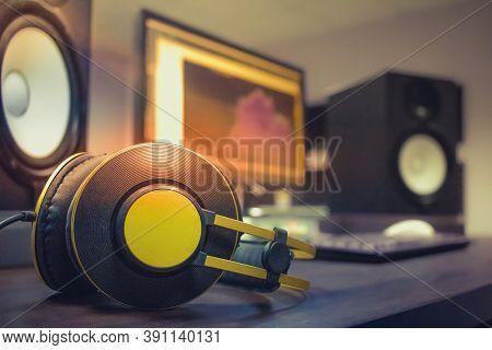 Professional Headphones On The Recording Engineer Table. Monitor Speakers For Audio Recording Studio