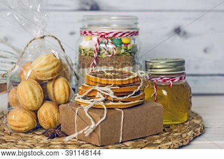 Homemade Christmas Food Gifts.homemade Cookies Nuts, Gingerbread, A Jar Of Honey, Dried Oranges, A M