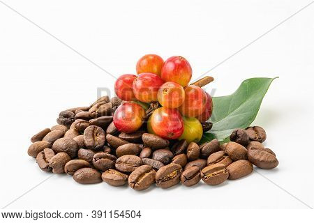 Bunch Of Coffee Fruit With Leaf And A Pile Of Coffee Beans On White Background With Clipping Path. T