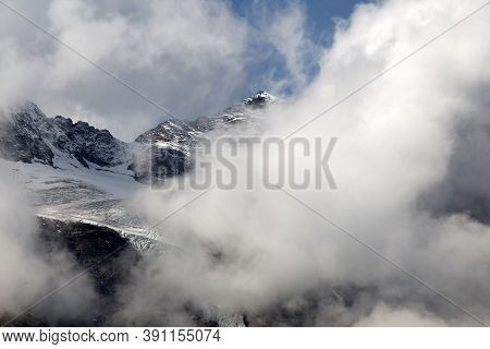 Close-up View Of Bernina Massif,  A Mountain Massif In The Western Rhaetian Alps, Located On The Bor