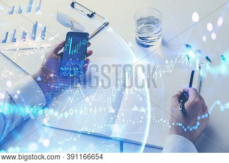Hands Of Businessman Using Smartphone In Blurry Office With Double Exposure Of Earth Hologram. Toned