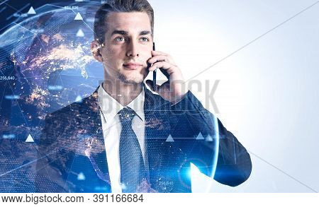 Young Businessman Talking On Smartphone Over White Background With Double Exposure Of Earth Hologram