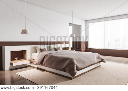 Interior Of Stylish Master Bedroom With White And Brown Walls, Tiled Floor And Comfortable King Size