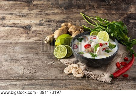 Traditional Thai Food Tom Kha Gai In Bowl And Ingredients On Wooden Table.copy Space