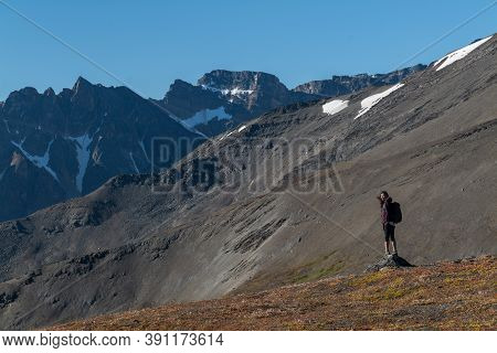 Asian Chinese Woman Standing On A Mountain Peak In Jasper National Park At The Top Of The Jasper Sky