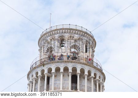 Pisa, Italy - April 24, 2019: Tourists On Top Of The Leaning Tower, The Most Famous Landmark Of The