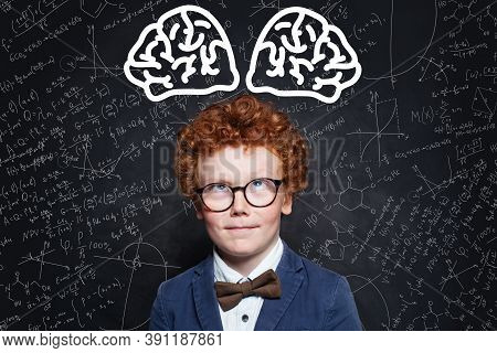 Smart Thinking Genius Child Student With Red Hair Portrait