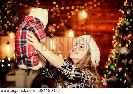 Happy New Year Concept. Dreams Come True. Kid Near Christmas Tree Hold Teddy Bear Soft Toy. Childhoo