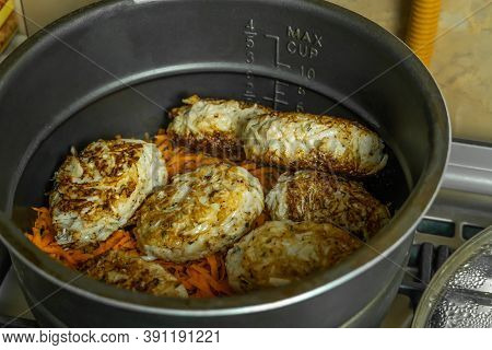 Homemade Cutlets In A Large Pot Close - Up In The Home Kitchen. Homemade Food
