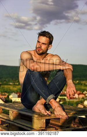 Muscular Strong Man Has Bristle On Face. Athletic Body Shape. Shirtless Guy Relax At Sunrise. Young