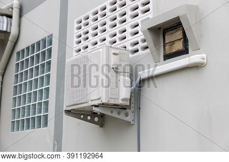 Air Conditioner Compressor Installed In Old Building. Outdoor Split Wall Type Air Conditioner Compre