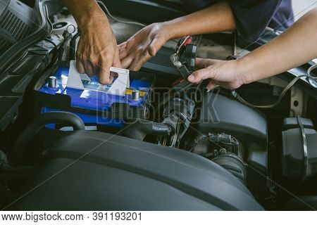 Engine Engineer Is Replacing  Car Battery Because Car Battery Is Depleted. Concept Car Maintenance A