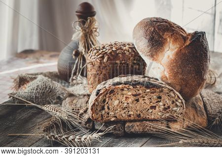 Freshly Baked Traditional Bread On A Wooden Board. Different Varieties Of Craft Bread. Homemade Hand