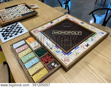 A Wooden  Monopoly Game Board, By Hasbro
