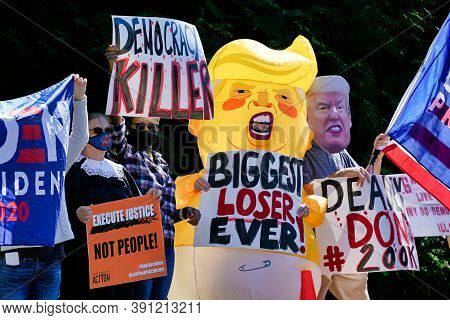 Protesters Gather Outside Trump National Golf Club In Sterling, Va., Sunday, Sept. 20, 2020, Before