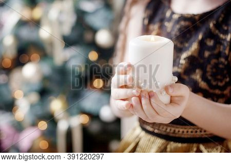 Burning Candle In The Hands Of A Girl. Christmas Candle. Christmas Decor. Child's Hands Holding Beau