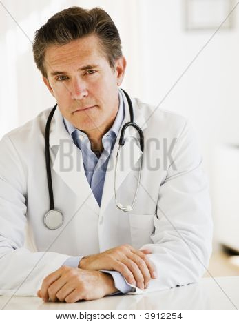 Doctor At Desk In Office