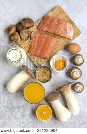 Vertical Composition With Products Rich In Vitamin D. Canned Tuna, Mushrooms, Salmon, Eggs, Milk, An
