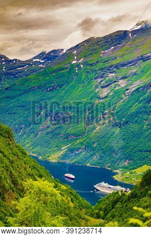 Fjord Geirangerfjord With Ferry Boats, Norway. Travel Cruising.