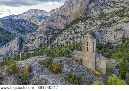 The Church Of Sant Andreu Del Castell De Tona, In The Catalan Region Of Osona. Next To It Are The Re