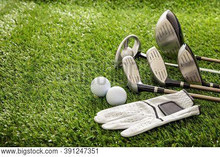 Golf Equipment, Sticks Set, Glove And Golfballs On Green Course Lawn, Close Up View. Golfing Sport A