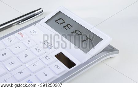 The White Calculator On White Background And Word Dept In Display. High Quality Photo