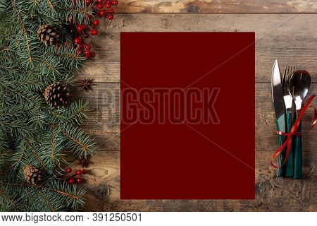 Mockup Christmas Menu On Dark Wooden Table. Christmas Cookbook Or Menu. Christmas Table Setting With