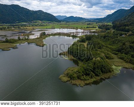 Aerial View On The Upper Ends Of Ossiacher Lake In Carinthia, Austria With Its Moor And Marshlands O